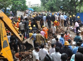 The overnight death toll in the building crash here shot up to 17 even as rescue operations continued on Wednesday morning, an official said. Five more bodies were recovered from the debris of the Sai Darshan building at Damodar Park area in Ghatkopar which collapsed like a pack of cards on Tuesday morning.