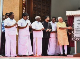 Prime Minister Narendra Modi on Thursday inaugurated former President A.P.J. Abdul Kalam's memorial in Tamil Nadu's Ramananthapuram district. Modi also flagged off 'Kalam Sandesh Vahini', an exhibition bus which would travel across various states and reach Rashtrapati Bhavan on October 15, the 86th birth anniversary of the former President. The memorial at Pei Karumbu was built by the Defence Research and Development Organisation (DRDO) at an outlay of around Rs 16 crore in a year's time. Prior to cutting the ribbon and entering the memorial, Modi hoisted the national flag at the site. Inside the memorial Modi also unveiled the veena playing Kalam's statue, offered floral tributes and interacted with the family members of the former President, who hailed from Rameswaram.