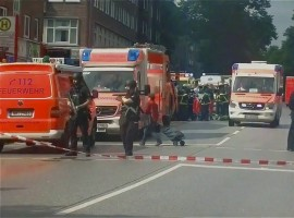 Security forces and ambulances after a knife attack in a supermarket in Hamburg.