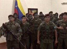 A still image from video released by Operation David Carabobo purportedly shows a group of men dressed in military uniforms announcing uprising in Valencia, Venezuela August 6, 2017.