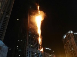 Flames shoot up the sides of the Torch tower residential building in the Marina district, Dubai, United Arab Emirates.