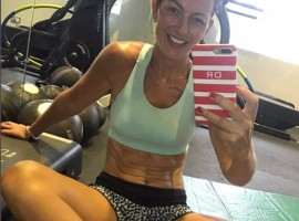 Television presenter Davina McCall flaunts her washboard abs.