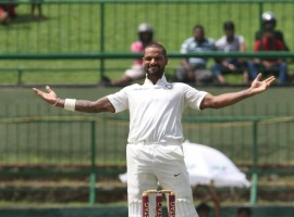 Sri Lanka hit back with three quick wickets even as Shikhar Dhawan's sixth Test ton helped India reach 235/3 at tea on the opening day of the third and final Test at the Pallekele International Cricket Stadium here on Saturday. Skipper Virat Kohli (11 not out) and Ajinkya Rahane (3 not out) went into the break undivided after left-arm spinner Malinda Pushpakumara packed off the opening duo of Shikhar Dhawan and Lokesh Rahul. Chinaman Lakshan Sandakan got the crucial wicket of one-down Cheteshwar Pujara just before the break.