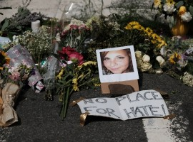 Flowers and a photo of car-ramming victim Heather Heyer lie at a makeshift memorial in Charlottesville, Virginia.