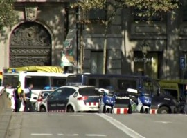 A still image from video shows a police cordon on a street in Barcelona.