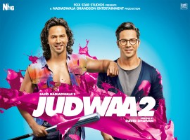 This brand new poster has Varun Dhawan's twin avatars, one posing as the tapori Raja with a baseball bat giving out a bold look and the other as the geeky Prem posing in a humble manner. The poster looks very bright and colorful giving out a happy and cheerful vibe. Both are completely contrasting avatars that Varun Dhawan will be seen playing. Varun Dhawan has never been seen with long hair on screen and nor has he worn a spectacle before but in Judwaa 2 the actor will be seen trying many of his firsts. Varun will be seen slipping into the shoe of Salman Khan who played the most iconic twin characters of Raja and Prem. The two leading ladies, Jacqueline Fernandez and Taapsee Pannu will be seen playing the love interest of Varun's twin roles. The 1997 Judwaa was a big hit. After 20 years the duo of Sajid and David are back to recreate the magic Jodi of Raja and Prem on the big screen which has taken the excitement level of the audience towering high.