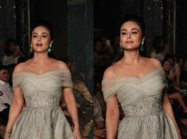 Bollywood actress Preity Zinta turned showstopper for designer duo Shane and Falguni Peacock in an off-shoulder floor-length smoky grey gown with exquisite emerald earrings that made her look like royalty.