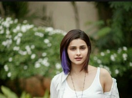Prachi Desai is known to break rules, be it on the professional front or personal. This Bollywood actress makes her own rules and sticks by it with all her heart. Her fashion sense is quite different from the rest of the Bollywood actresses too, and this time around she's gone an extra mile for the rockstar that she plays in her next by colouring her hair purple.