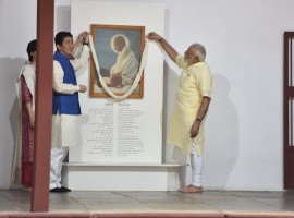 Keeping a date with history, Prime Minister Narendra Modi and his Japanese counterpart Shinzo Abe on Wednesday visited the Sabarmati Ashram soon after the latter's arrival here on a two-day visit. The two leaders and Japan's First Lady Akie Abe paid floral tributes to a portrait and a bust of Mahatma Gandhi. Modi took the visiting dignitaries on a tour of the Ashram as the trio posed for pictures, including one in front of a charkha. After his return to India from South Africa, Mahatma Gandhi set up his first ashram at Kochrab in Ahmedabad in May 1915 but then shifted it to the banks of the Sabarmati river in June 1917.