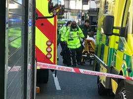 Emergency personnel attend to a person after an incident at Parsons Green underground station in London.