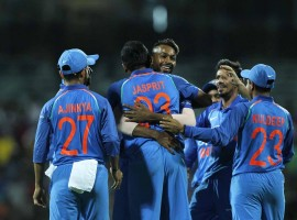 India rode on MS Dhoni and Hardik Pandya's all-round brilliance to thrash Australia by 26 runs by Duckworth-Lewis method in a rain-truncated opener of the five-match One-day International series at the M.A. Chidambaram Stadium here on Sunday. After guiding India to safety with a career-best 83 off 66 balls, the 23-year-old Pandya starred with the ball, picking the key wickets of Australia skipper Steve Smith (1) and Travis Head (5) to enable the hosts go 1-0 up in the series. Chasing a revised target of 164 from 21 overs after a spell of heavy showers truncated play, Australia were reduced to 29/3 with debutant opener Hilton Cartwright (1), Smith and Head back in the pavilion. Such was India's domination in the second innings of the match that only three of the visiting batsmen could manage to reach double-figures and Australia were restricted to 137/9.