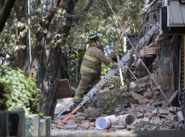 A fireman works on the site of a collapsed building after an earthquake in Mexico City, capital of Mexico, on Sept. 19, 2017. More than 100 people were killed in a powerful 7.1-magnitude earthquake that hit central Mexico on Tuesday, and the number of deaths is expected to rise due to the scale of the quake.