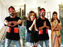 The team of Judwaa 2 have been on a promotional spree as the film is closer to release. The latest destination for the team is Kolkata, with actors Varun Dhawan, Jacqueline Fernandez and Taapsee Pannu reaching the city for promotions. Varun Dhawan was seen at Mumbai Airport donning his Raja look, complete with a Bandana as the Judwaa 2 actor departed for Kolkata. While in the city, Varun Dhawan took to his tapori Raja avatar to goof around with actress' Jacqueline Fernandez and Taapsee Pannu.