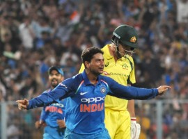 Chinaman Kuldeep Yadav bagged a hat-trick as India rode a dominant bowling performance to restrict Australia to 202 and win the second One Day International (ODI) by 50 runs at the Eden Gardens here on Thursday. In three successive deliveries, Kuldeep (3/54) took the wickets of Mathew Wade, Ashton Agar and Pat Cummins in the 33rd over to become the second bowler in limited overs cricket to script a hat-trick at this venue and only the third Indian to record the rare feat in 50 overs cricket. The other Indians to get hat-tricks are Kapil Dev and Chetan Sharma, with Dev grabbing his treble at the Eden against Sri Lanka in 1991. Sharma bagged it in 1987. Besides Kuldeep, Bhuvneshwar Kumar (3/9), Yuzvendra Chahal (2/34) and all-rounder Hardik Pandya (2/56) starred with the ball for the hosts as Steve Smith (59) and Marcus Stoinis (62 not out) scored half-centuries for the tourists.