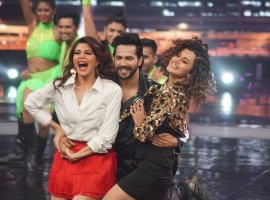 Actors Taapsee Pannu, Varun Dhawan and Jacqueline Fernandez perform during the promotion of their upcoming film