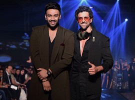 Bollywood actor Hrithik Roshan walks the ramp for designer Nikhil Thampi.