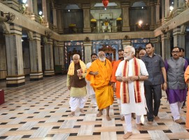 Prime Minister Narendra Modi on Friday evening visited the famous Tulsi Manas and Durga Kund temples here and offered his prayers. Accompanied by Uttar Pradesh Governor Ram Naik and Chief Minister Yogi Adityanath, Modi sought to know detailed information about the Manas temple, which was inaugurated by then President Sarvapalli Radhakrishnan in 1964.