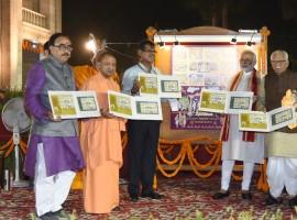 Prime Minister Narendra Modi releases a postal stamp on