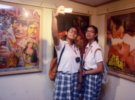 Students during an exhibition organsied on Amitabh Bachchan's 75th birthday in Kolkata.