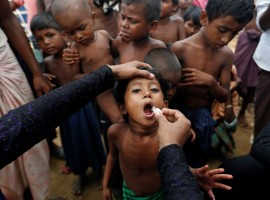 A Rohingya refugee child gets an oral cholera vaccine in a refugee camp near Cox's Bazar, October 11, 2017. Aid workers worry they lack the staff to get the vaccines out quickly, while the WHO says it urgently needs $10.2 million to do the job properly. The first round of the vaccination campaign will cover 650,000 people aged one year and older. A second round will target 250,000 children aged between one and five with an additional dose for extra protection.