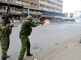 Riot policemen fire tear gas to disperse supporters of Kenyan opposition National Super Alliance (NASA) coalition, during a protest along a street in Nairobi.