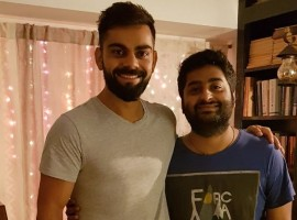 Virat took to Twitter on Tuesday to share a photograph of himself along with Arijit and said the singer is an