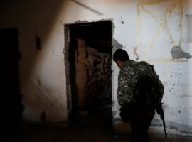 A fighter of the Syrian Democratic Forces inspects a bunker of the Islamic State militants under the stadium in Raqqa, Syria.