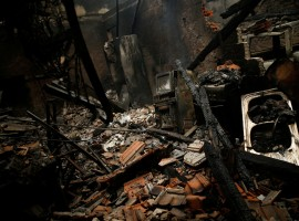 A burnt house is seen following a forest fire in Vila Nova, near Vouzela, Portugal, October 16, 2017.