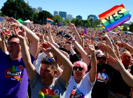 Supporters of the 'Yes' vote for marriage equality celebrate after it was announced the majority of Australians support same-sex marriage in a national survey, paving the way for legislation to make the country the 26th nation to formalize the unions by the end of the year, at a rally in central Sydney.