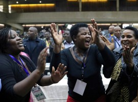 Delegates celebrate after Zimbabwean President Robert Mugabe was dismissed as party leader at an extraordinary meeting of the ruling ZANU-PF's central committee in Harare, Zimbabwe November 19, 2017.
