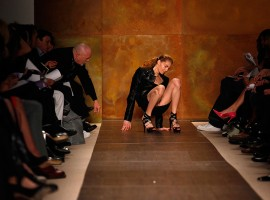 A model slips and falls while presenting a creation from the Herve Leger by Max Azria Fall 2009 collection during New York Fashion Week.