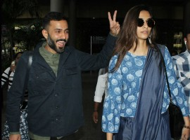 Sonam Kapoor and Anand Ahuja return from Singapore.