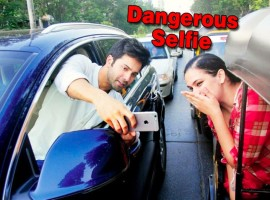The official Twitter handle of Mumbai Police shared snapshots of a newspaper article featuring Varun pulling off the selfie stunt on the road. The actor is seen partly out of his car's window and taking a selfie with a female fan who is seen travelling in an auto rickshaw.