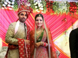 Bhuvneshwar Kumar and Nupur Nagar pose for the photographers.