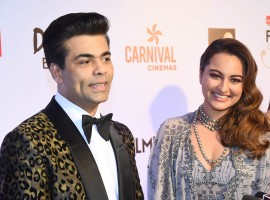 Karan Johar and Sonakshi Sinha poses for the cameras at the Red carpet at the Reliance Digital and Filmfare Glamour and Style Awards 2017 held in Mumbai on December 01, 2017.