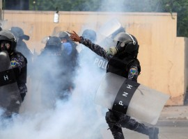 A military policeman throws a gas canister toward supporters of Salvador Nasralla during a protest caused by the delayed vote count for the presidential election in Tegucigalpa, Honduras November 30, 2017.