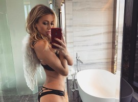 Olivia Attwood displays her peachy derriere as she strips down to her lingerie.