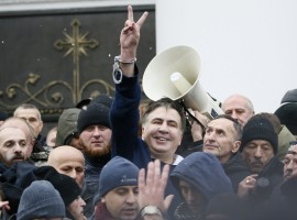 Georgian former President Mikheil Saakashvili flashes a victory sign after he was freed by his supporters in Kiev, Ukraine December 5, 2017.