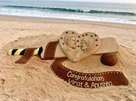 Sand artist Sudarsan Pattnaik has wished newly weds cricket star Virat Kohli and actress Anushka Sharma with this stunning art.