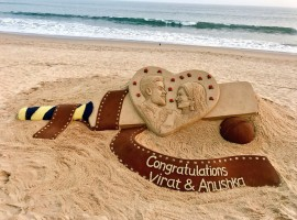 Sand artist Sudarsan Pattnaik has wished newly weds cricket star Virat Kohli and actress Anushka Sharma with this stunning art.