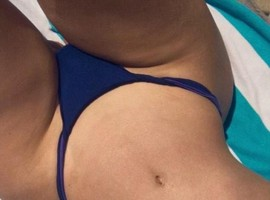 Iggy Azalea gives fans an eyeful in saucy sunbathing selfie.
