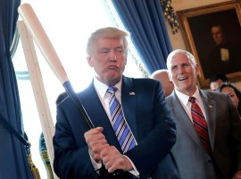 ice President Mike Pence laughs as U.S. President Donald Trump holds a baseball bat as they attend a Made in America product showcase event at the White House in Washington, U.S., July 17, 2017. Carlos Barria: