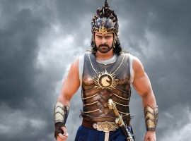 """Baahubali superstar, Prabhas, to whom the year 2017 belonged, is featuring on the first cover of GQ magazine in this new year, the January 2018 issue. A usually low profile star finally decided to make his debut on magazine cover by shooting for the premium men magazine. Yes, while the superstar has featured on many magazine covers in the past, this is for the first time that he has shot for a magazine cover. Dressed in a 3 piece suit and a tie, GQ has titled the cover """"The phenomenon Prabhas reigns"""" and we couldn't agree more with their cover line. He absolutely looks like a king sitting on his throne."""