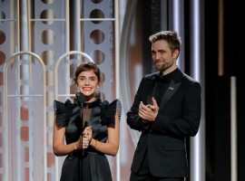 Emma Watson and Robert Pattinson speaks onstage during the 75th Annual Golden Globe Awards.