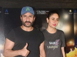 Saif Ali Khan and Kareena Kapoor Khan pose together as they arrive at the special screening of 'Kaalakaandi' in Mumbai on January 9, 2017.