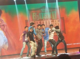 Actor Suriya dances with his fans during Thaanaa Serndha Koottam pre-release event.