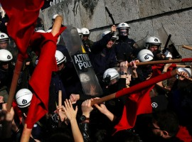 Protesters clash with riot police during a demonstration outside the parliament building against planned government reforms in Athens.