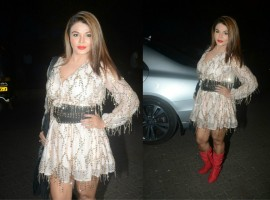Rakhi Sawant poses for photographers on her arrival at Mickey Contractor's MAC party in Mumbai.