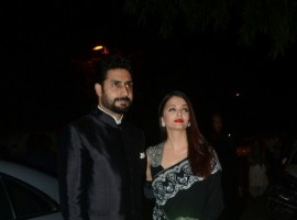 Celebrity couple Abhishek Bachchan and Aishwarya Rai Bachchan pose together as they arrive at Mickey Contractor's MAC party in Mumbai.