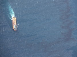 A Chinese rescue ship works to clean oil slicks from the sunken Iranian oil tanker Sanchi in the East China Sea, in this January 15, 2018 handout picture released by China's Ministry of Transport January 17, 2018.